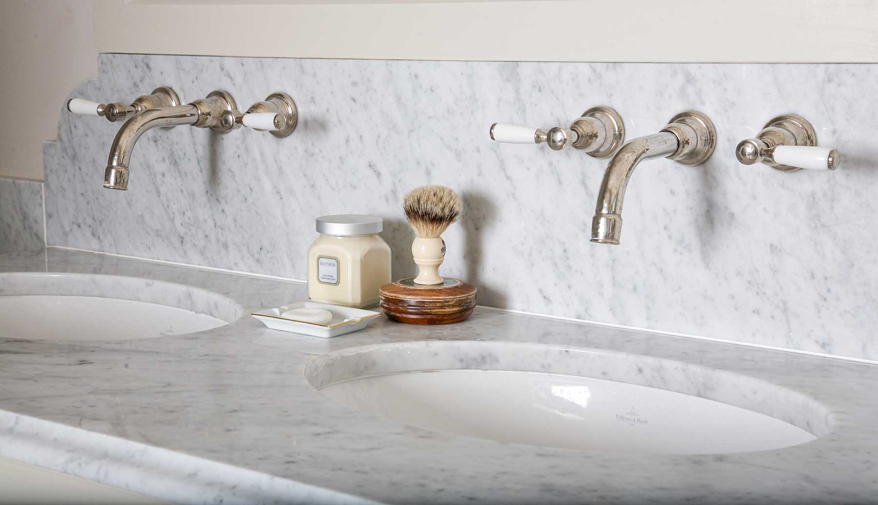 Double sink with grey and white marbling and silver taps.