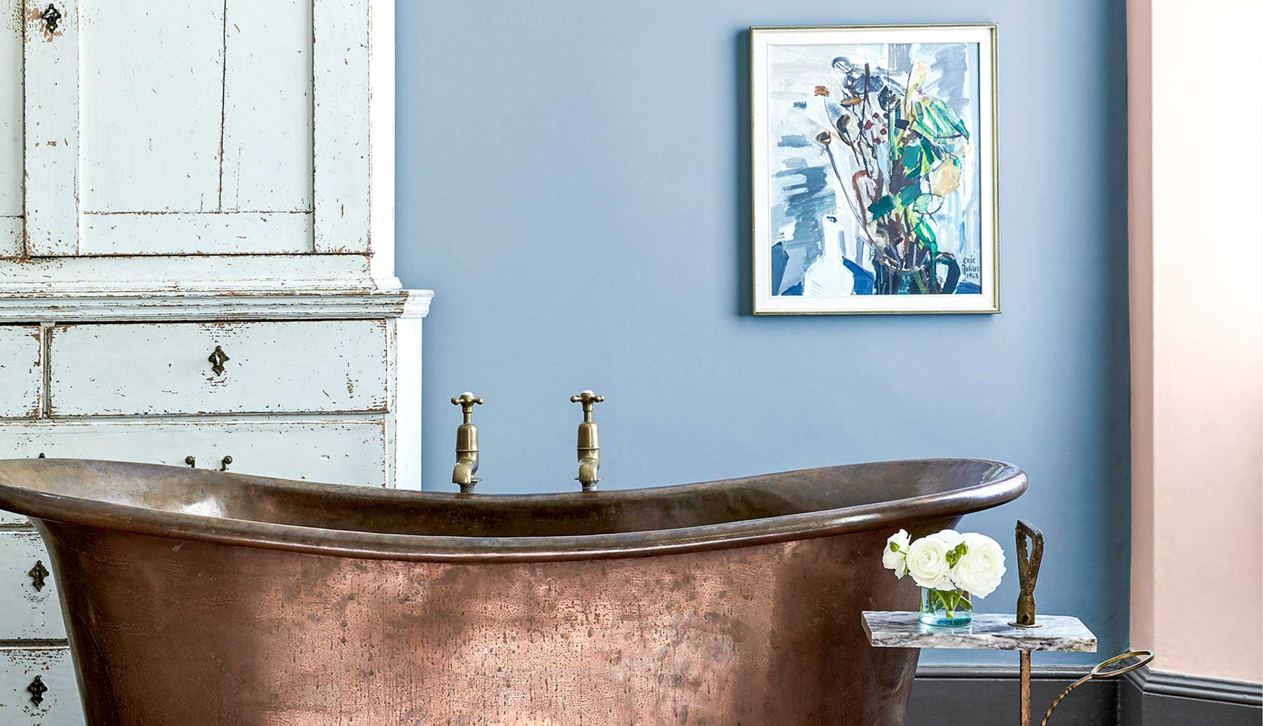 Bespoke copper bathtub with brass taps.