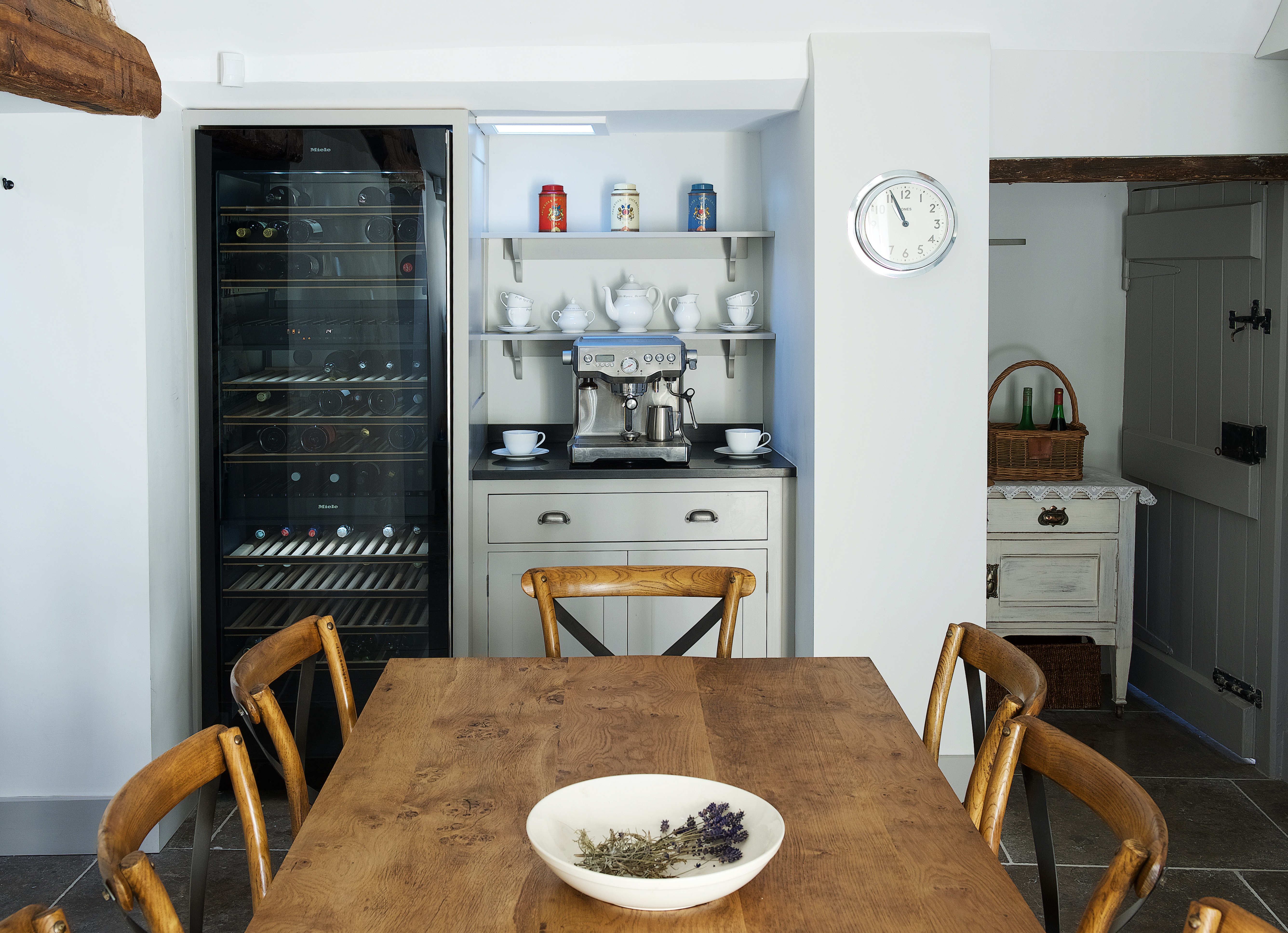 Miele wine fridge with bespoke shaker cabinets and shelves hand painted in Little Greene French Grey Dark with coffee machine.