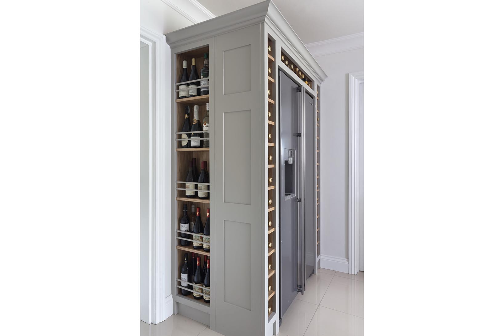 Samsung american style fridge freezer with wine storage built around it hand painted in Farrow & Ball Hardwick White.