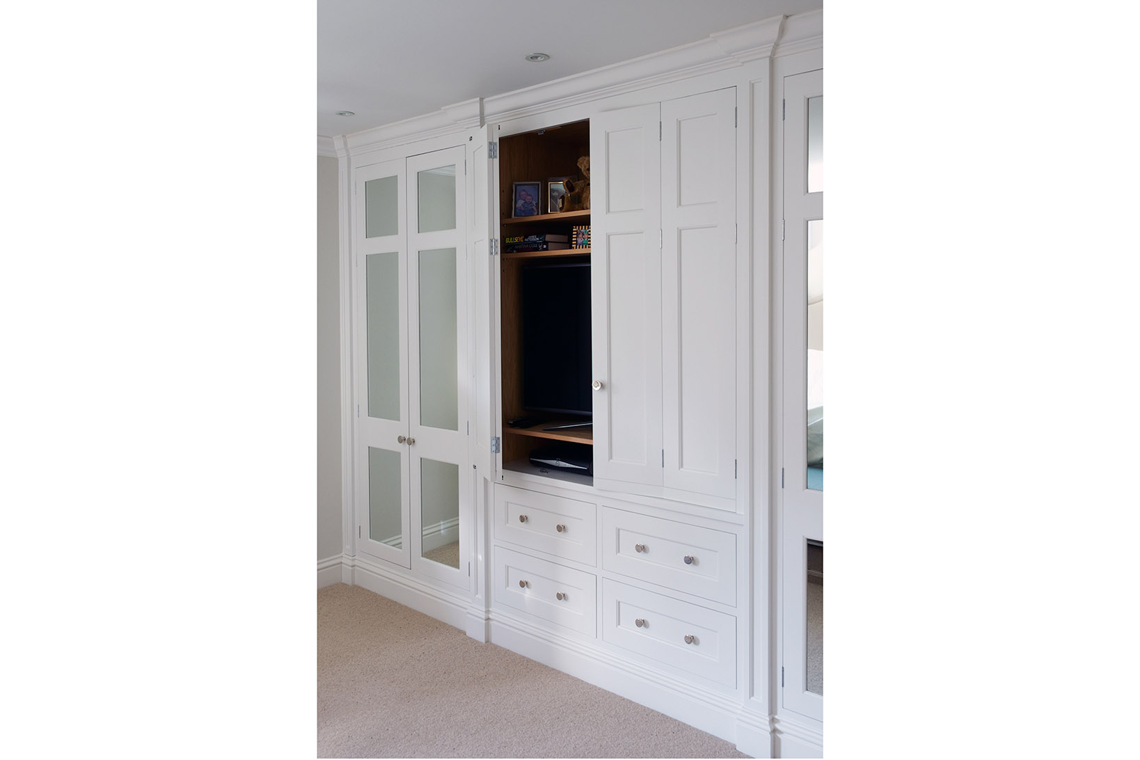 Bespoke shaker built in wardrobes painted in Zoffany Quarter Paris Grey with polished chrome handles and mirrored panels.