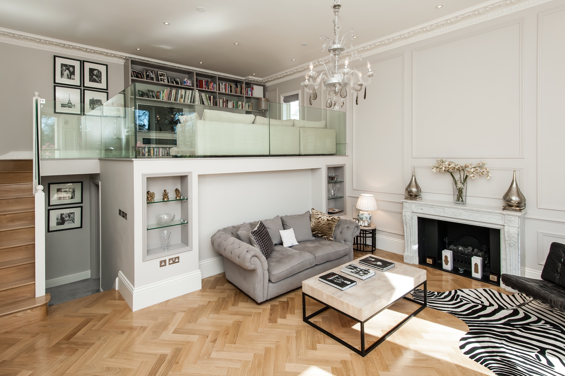 Living room and mezzanine with CK bespoke handmade built in storage and display shelving around the sofa