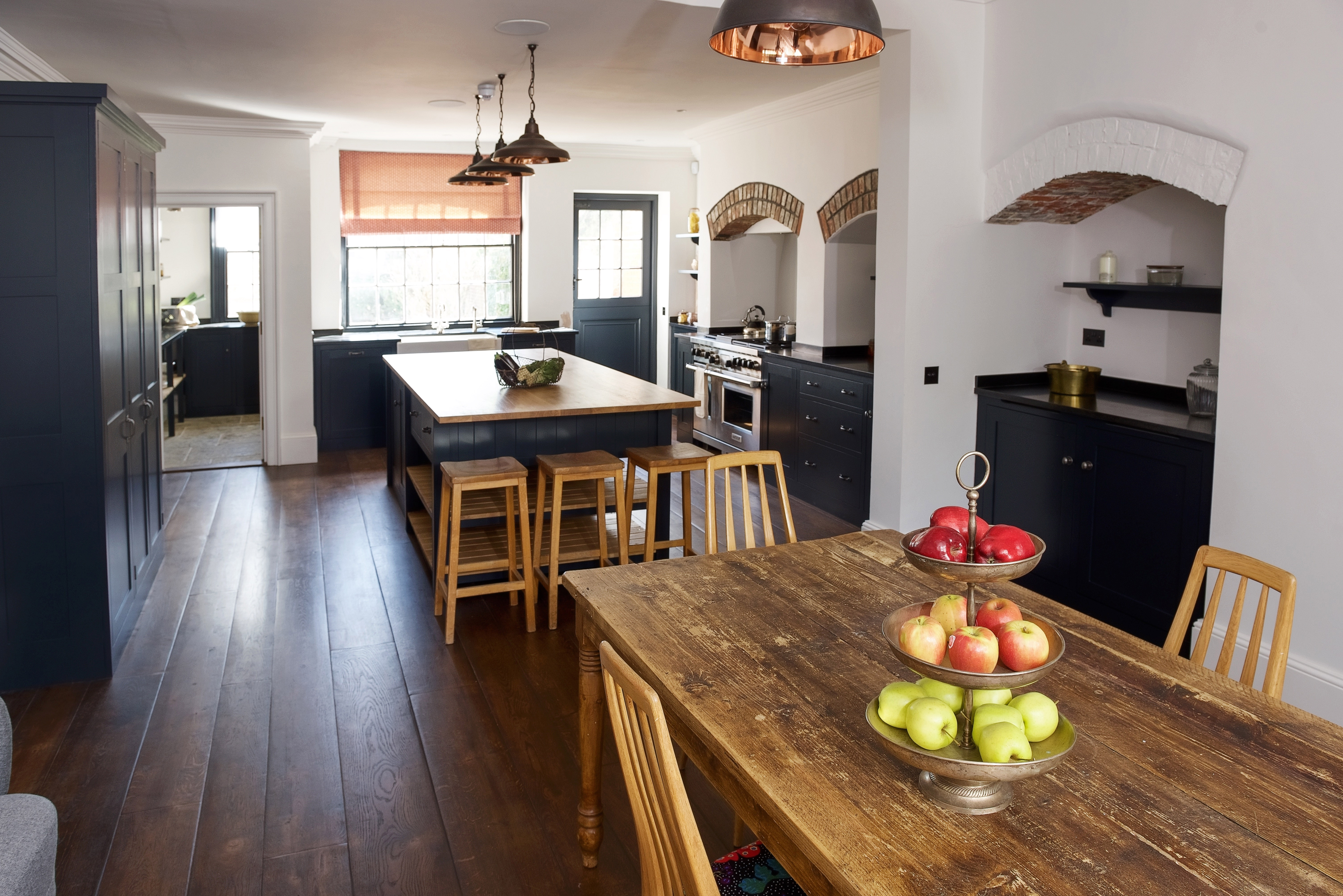 Bespoke shaker kitchen hand painted in Farrow & Ball Railings with black granite and oak worktops and vintage iron hardware.