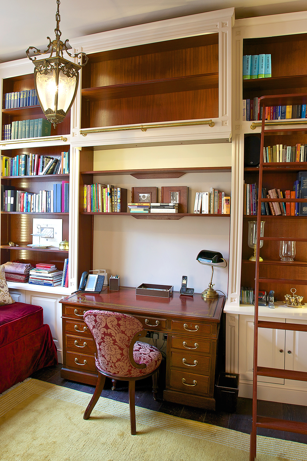 Charlie Kingham bespoke handmade study with built in shelves and sliding ladder on brass rail.