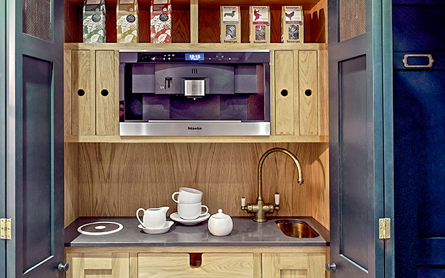 Open tea and toast cabinet with oak interior and Polaris instant hot tap and sink mixer and Miele microwave.