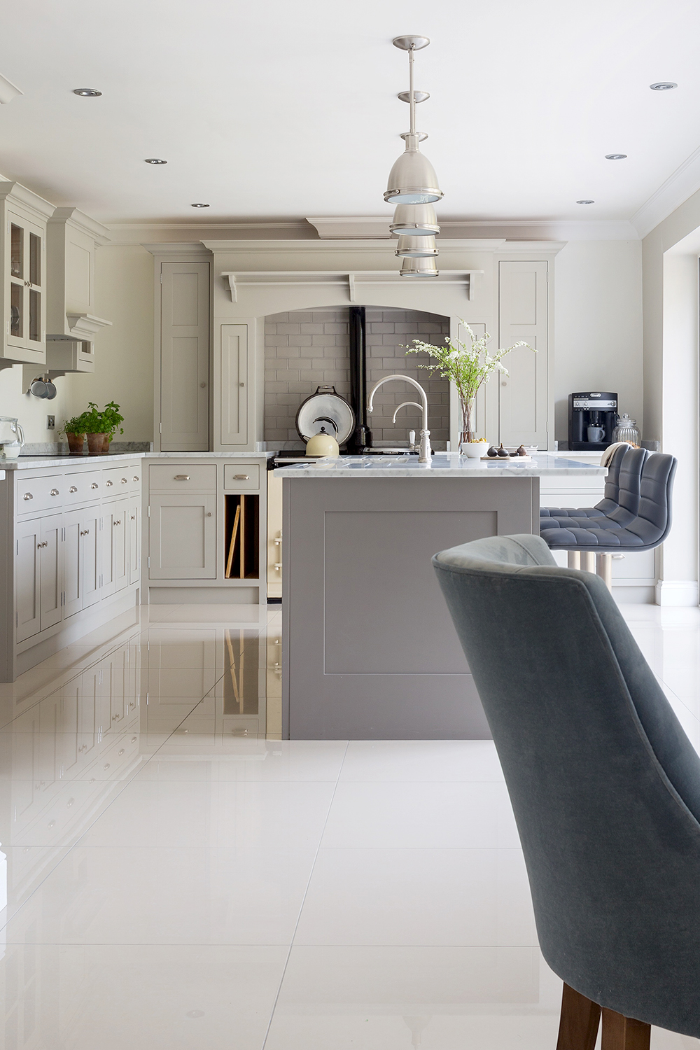 Bespoke grey Georgian classic kitchen with marble tops and large island with stools and a cream AGA.
