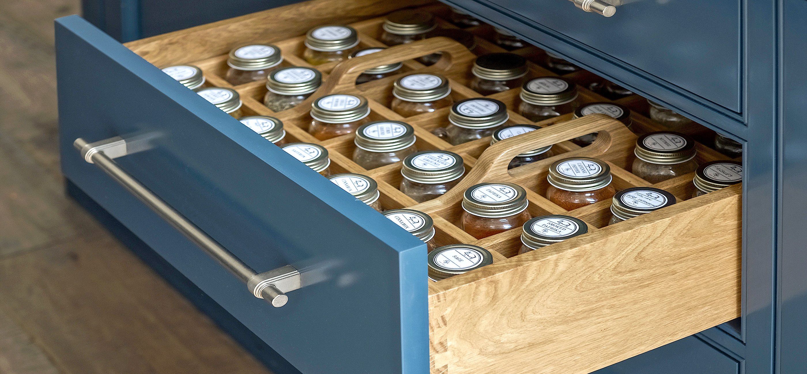 Close up of a bespoke Georgian drawer painted blue with spice compartments and solid oak interiors.