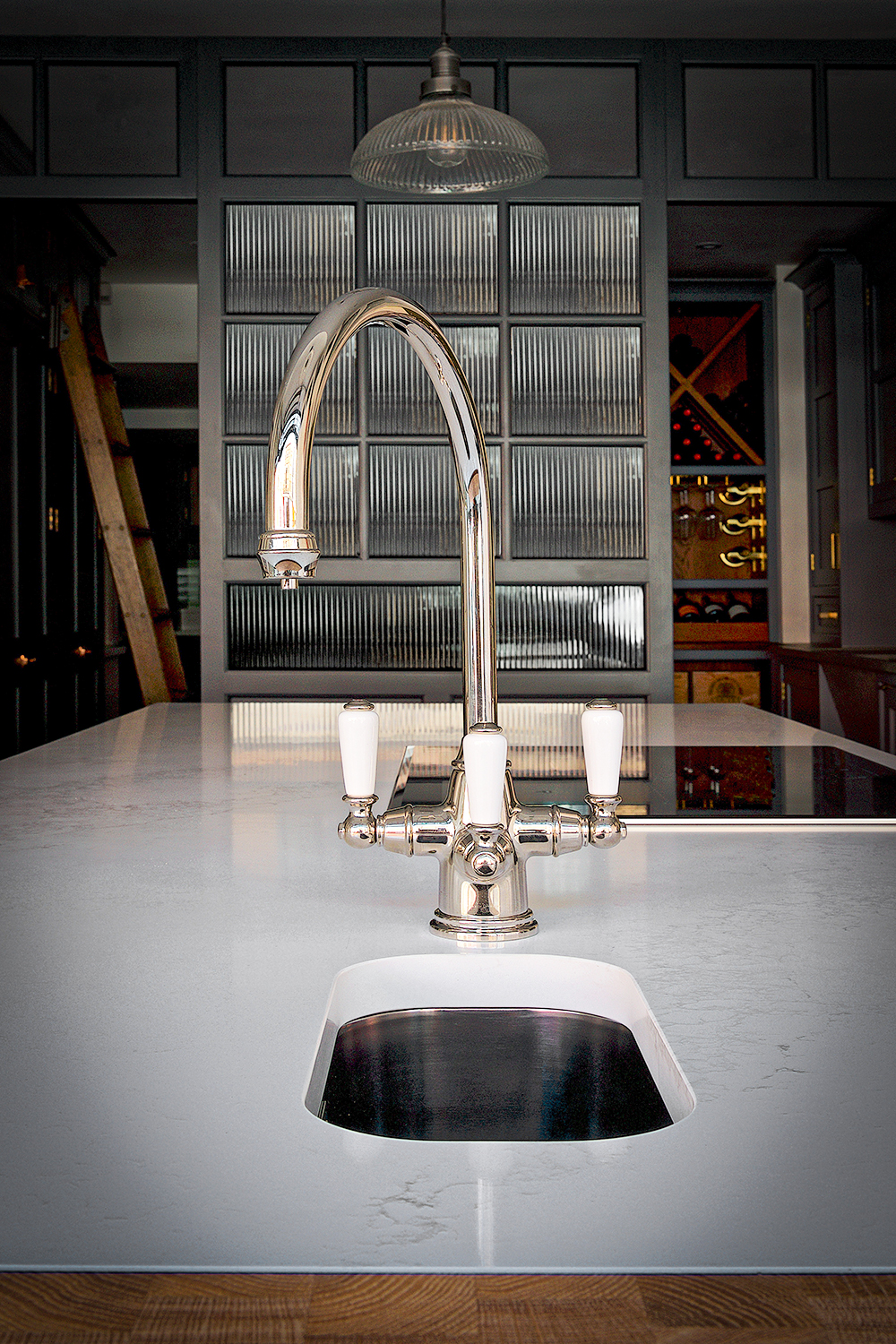 Perrin & Rowe Phoenician mixer tap in stainless steel finish on island with Caesarstone Calacatta Nuvo worktop.