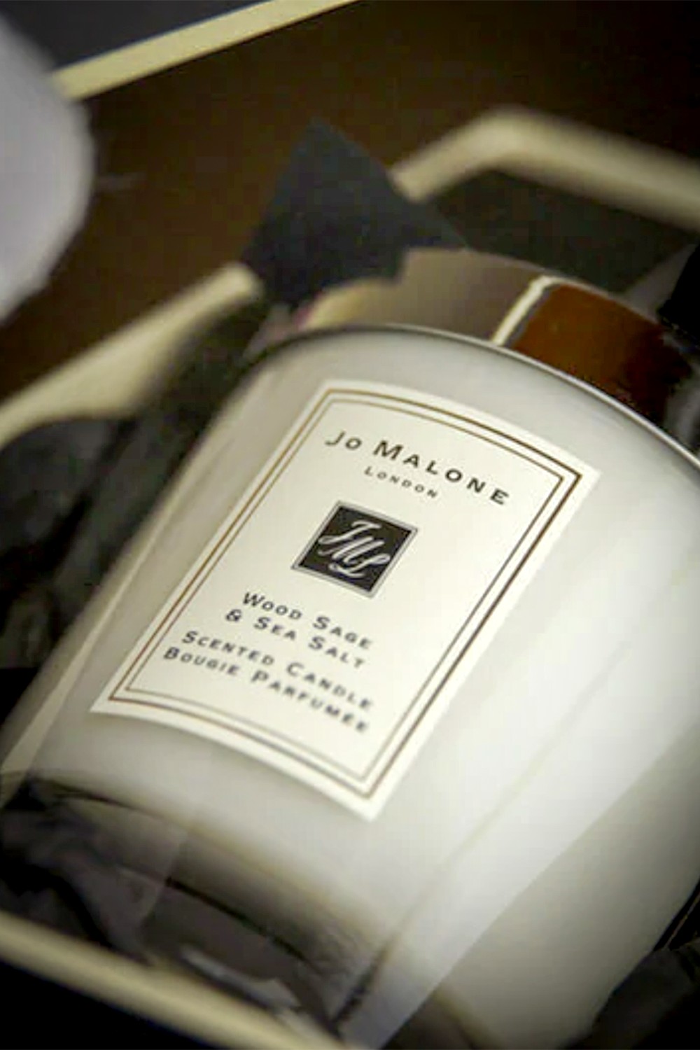 Jo Malone Wood Sage & Sea Salt candle in a display box.